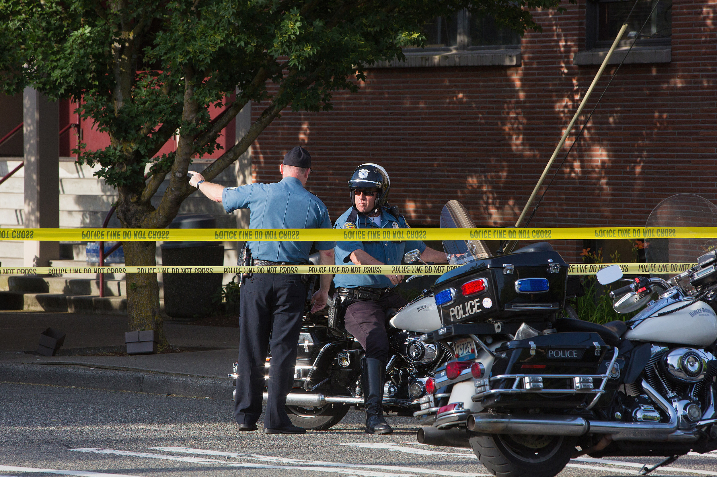 SEATTLE, WA - JUNE 05:  Seattle Police officers secure the crime scene after a shooting at Seattle Pacific University on June 5, 2014 in Seattle, Washington.  A gunman is in custody after four people were shot on campus resulting in one death. (Photo by Mat Hayward/Getty Images)
