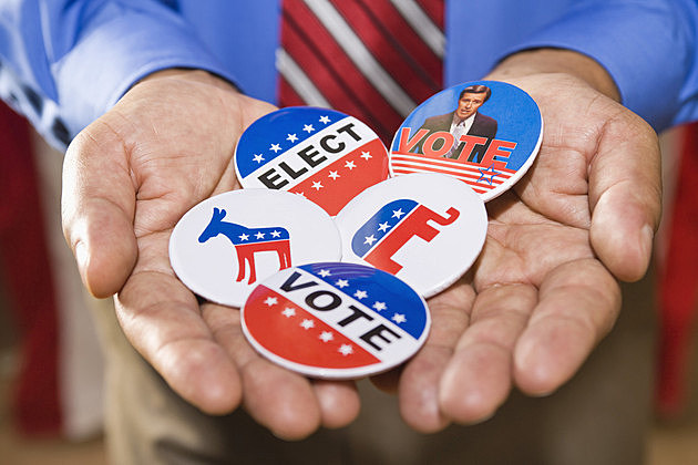 Holding political campaign buttons